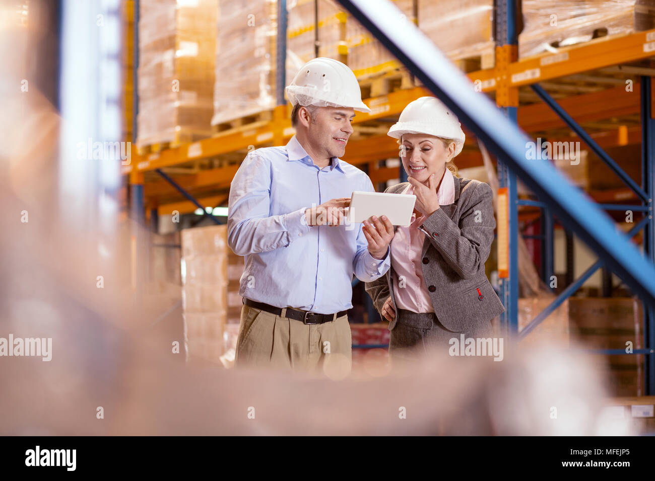 Positive business partners looking at the tablet screen - Stock Image