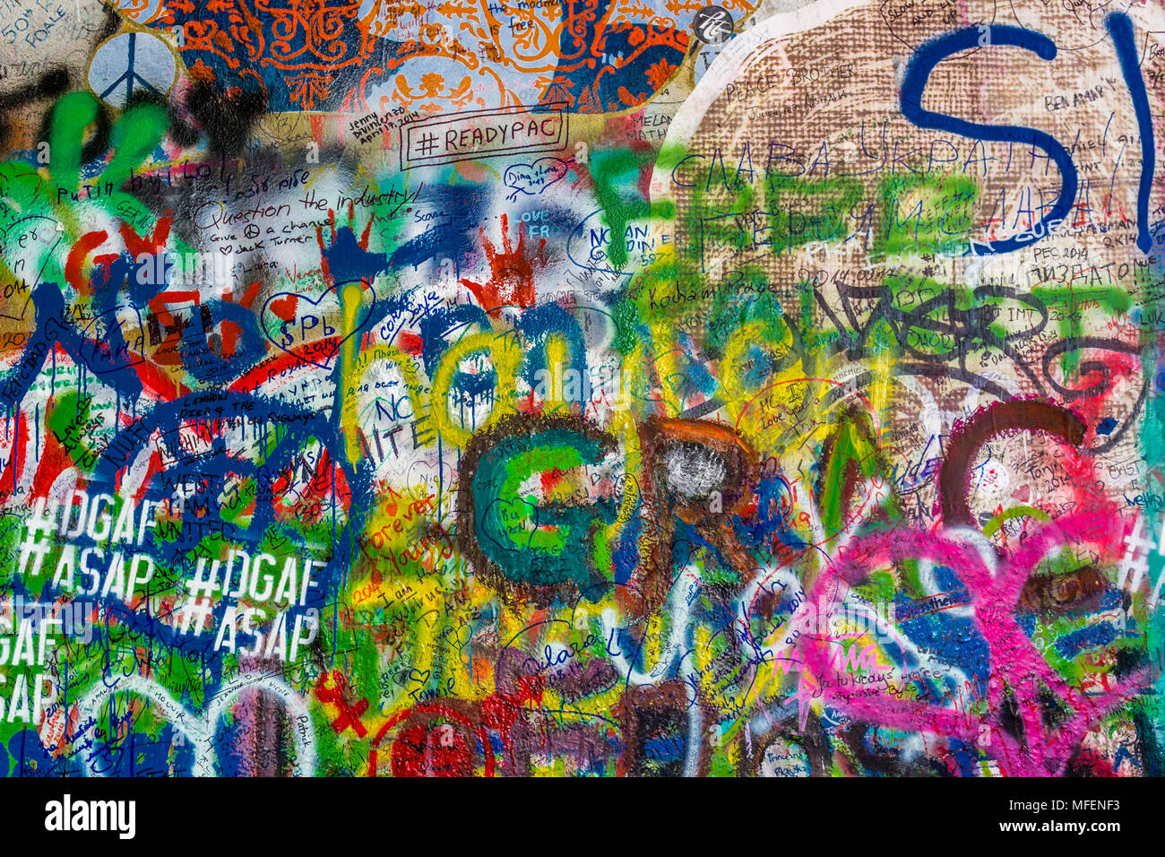 Prague czech august 28 2014 the lennon wall is a symbol for young people who keeps on drawing graffiti inspired by john lennon and beatles lyrics