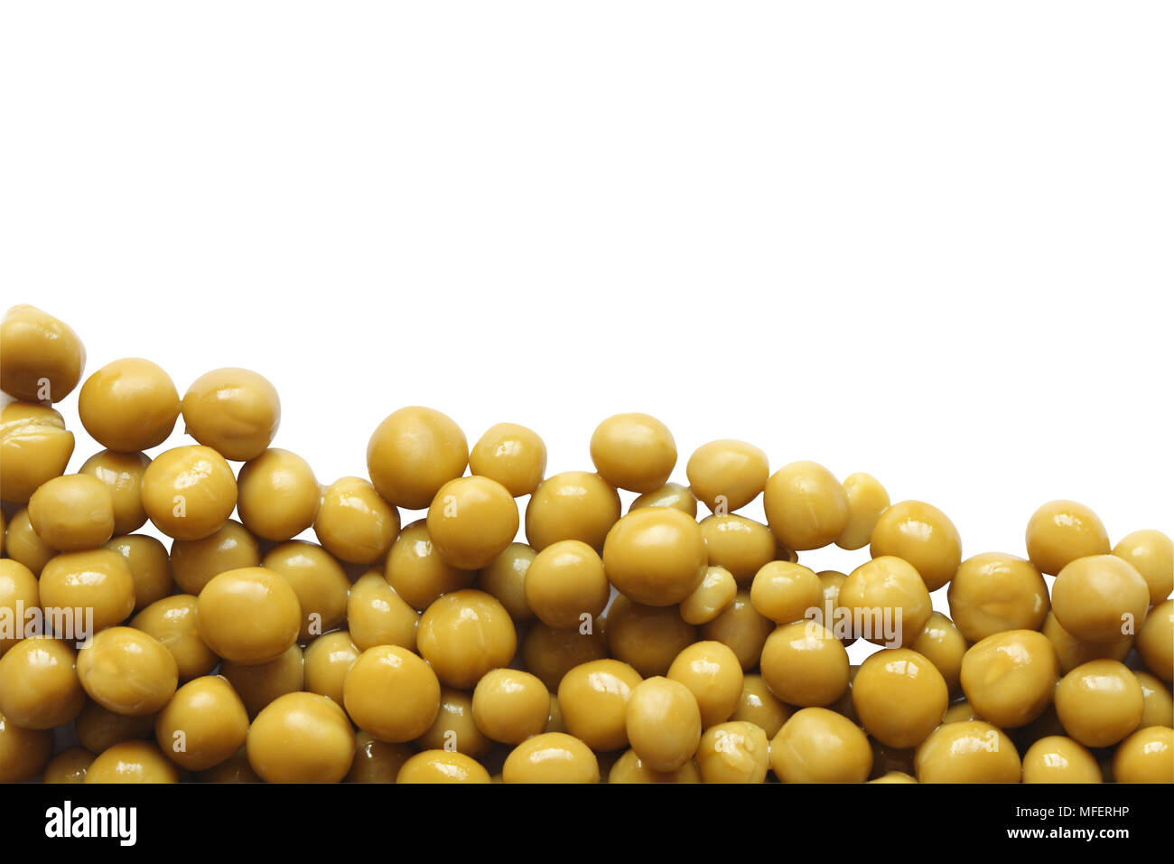 Preserved green peas isolated on white background with clipping path - Stock Image