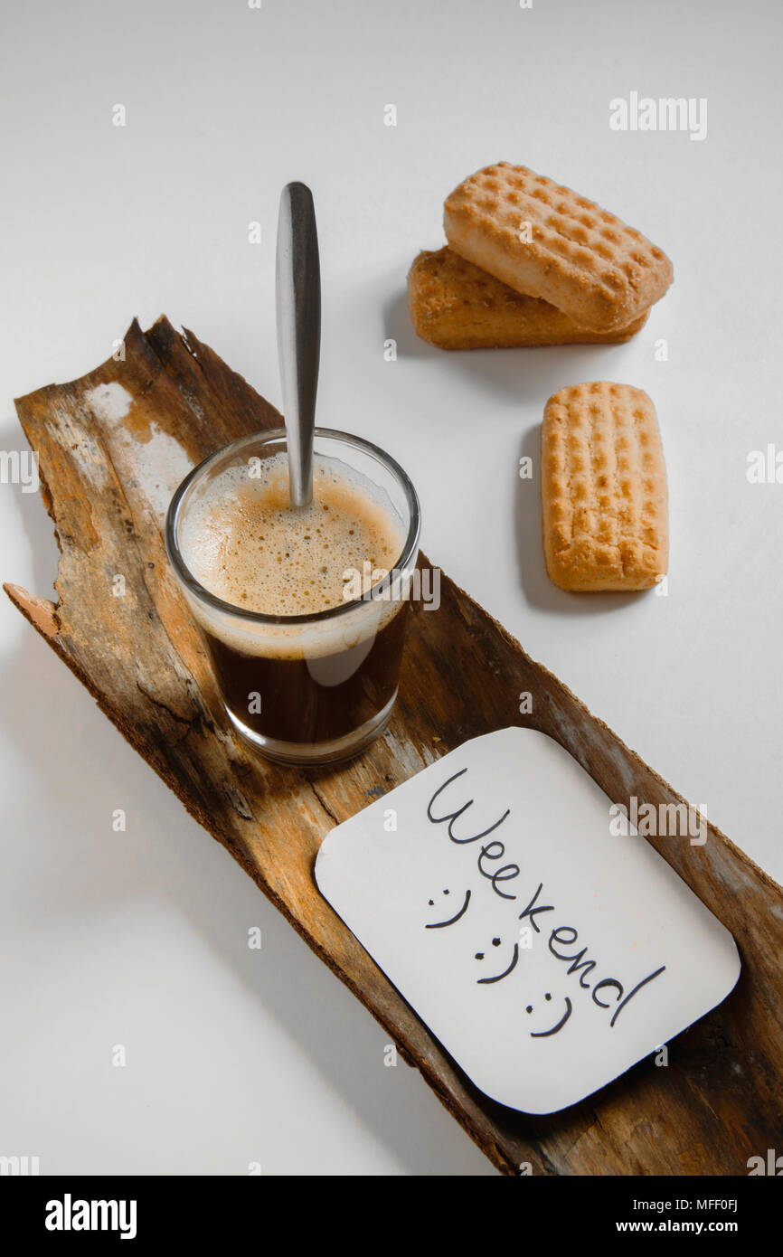 Iced coffee and cookies on table, flat lay style for weekend/holiday refreshing mood - Stock Image