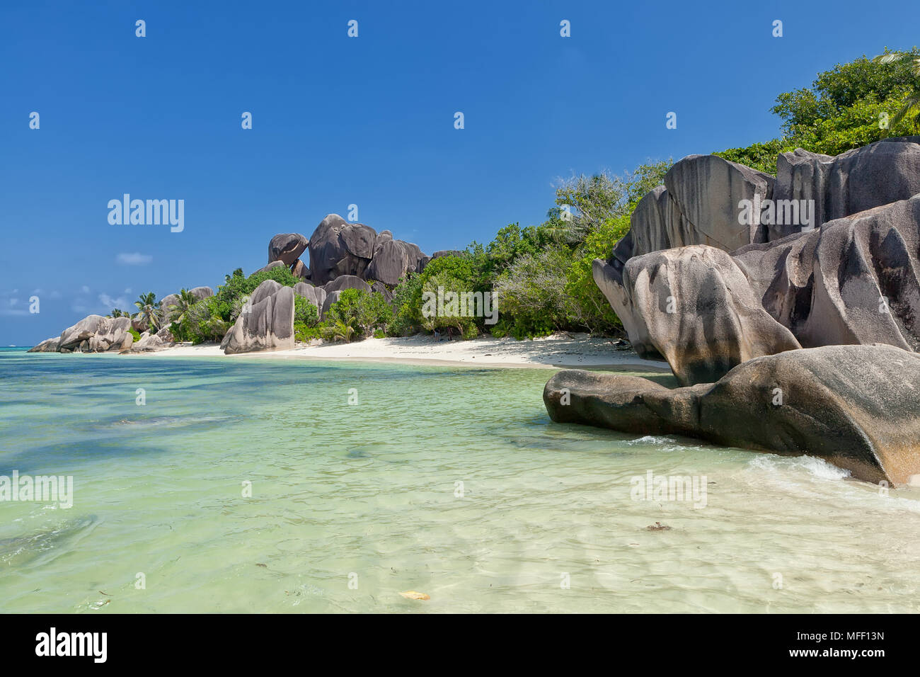 Anse Source d'Argent - granite rocks at beautiful beach on tropical island La Digue in Seychelles - Stock Image