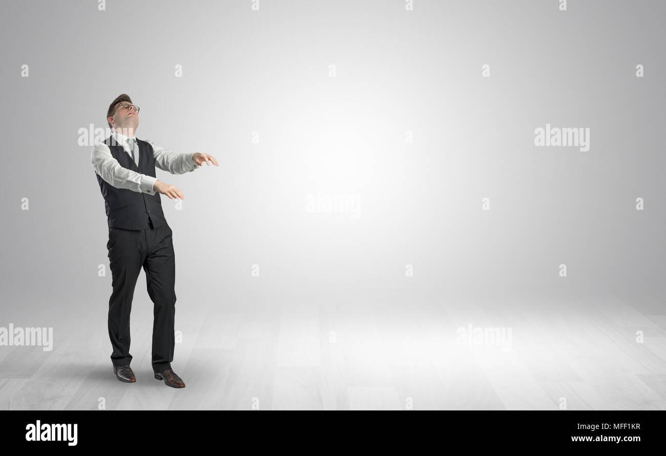 Zombi, sleepy maniac businessman walking in a copy space  - Stock Image