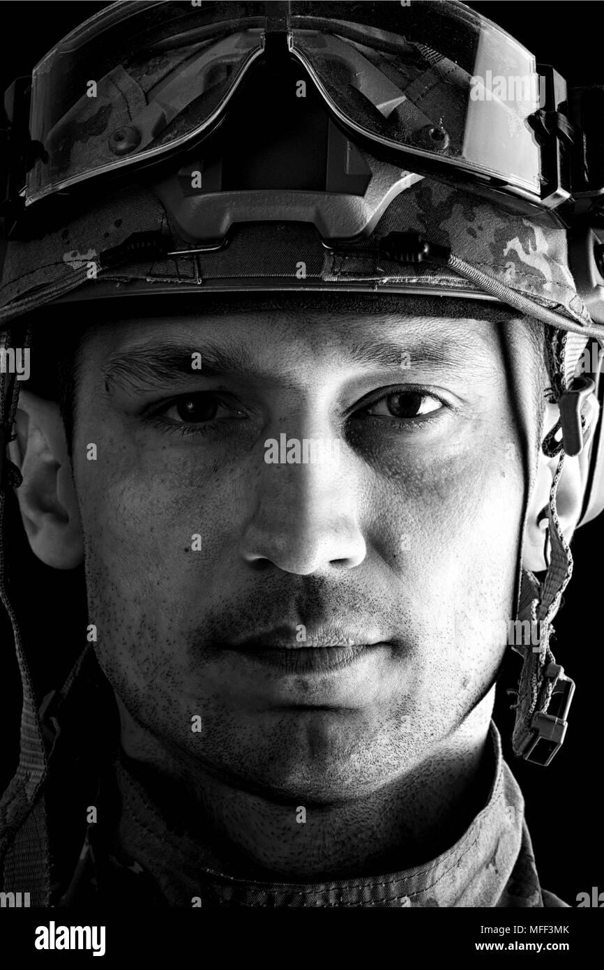 close up portrait of handsome military man. Macro shot on black background - Stock Image