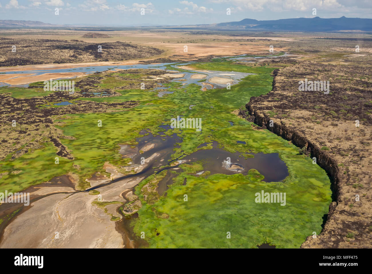 The Suguta river originates in a stream of water that emerges from the side of Mount Silali which is an extinct volcano. Stock Photo