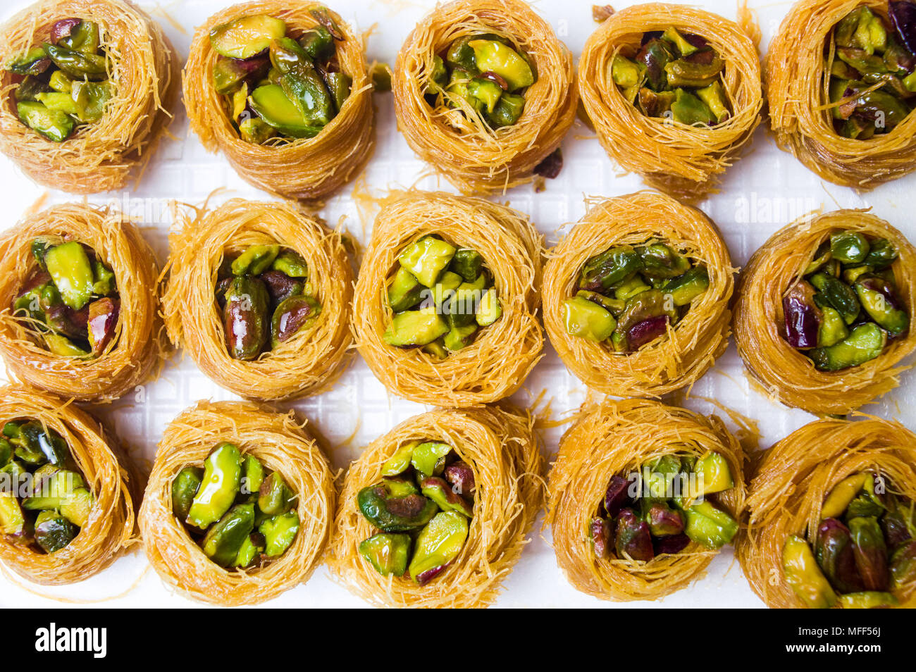 Arabic dessert with pistachio Mabroume top view pattern Stock Photo