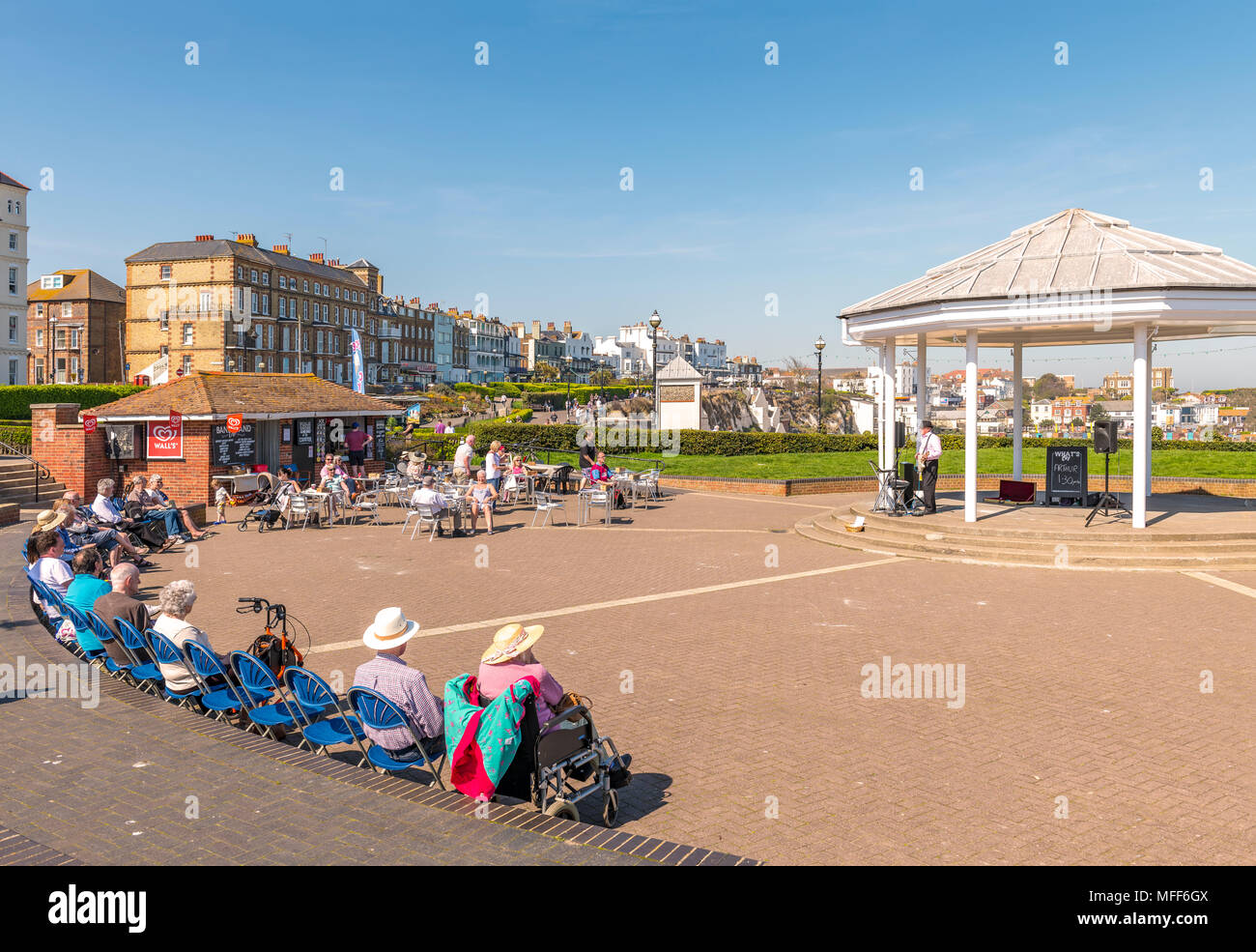 An entertainer called Arthur singing to an audience at the bandstand. Viking bay Broadstairs, Kent - Stock Image