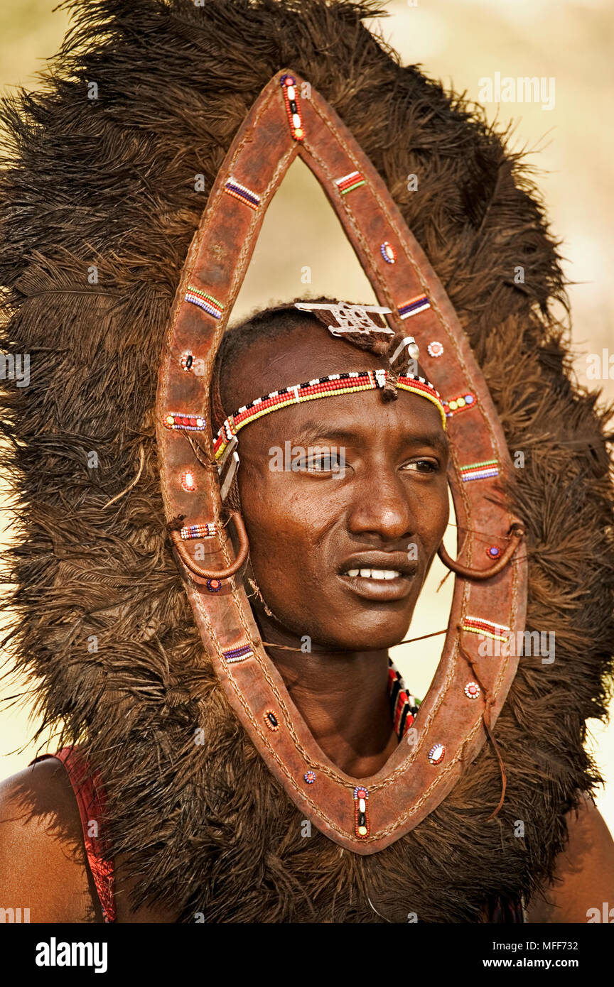 YOUNG MASAI MORAN (warrior youth) with ostrich feather headdress.   Near Amboseli National Park, Kenya - Stock Image