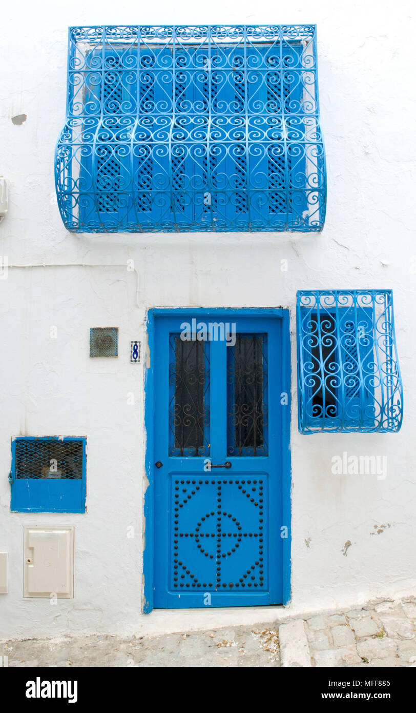Oriental design blue door with a pattern on a clay wall in Tunisia & Oriental design blue door with a pattern on a clay wall in Tunisia ...