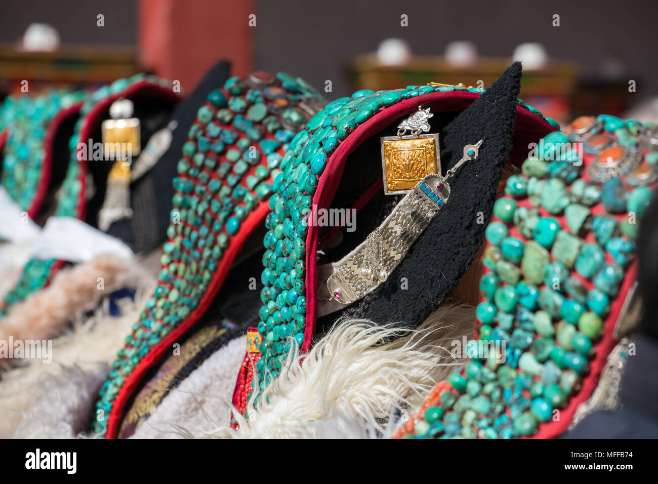 Zanskari women wearing ethnic traditional Ladakhi headdress with turquoise stones called Perakh Perak, Ladakh, India - Stock Image