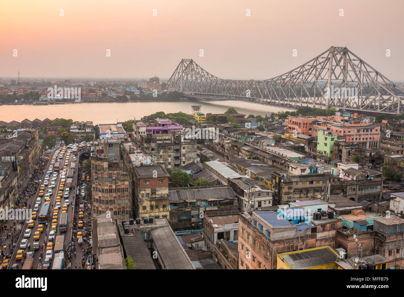 Kolkata, India - April 13, 2017: Beautiful view of Kolkata city with a Howrah bridge on the river Hooghly during sunset. Stock Photo