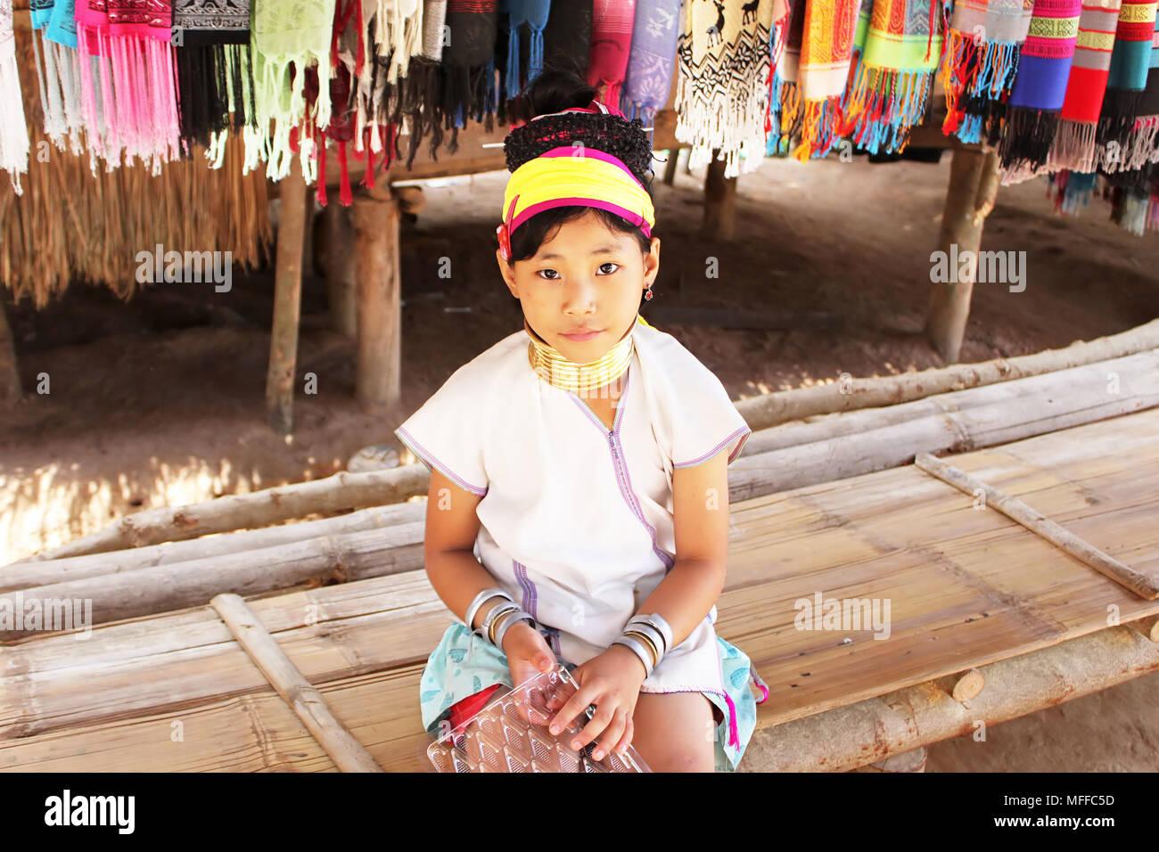 MAE HONG SON, THAILAND - JUNE 17, 2014: Unidentified Karen tribal girl near Mae Hong Son, Thailand, Chiang rai, Karen Long Neck hill tribe village Stock Photo