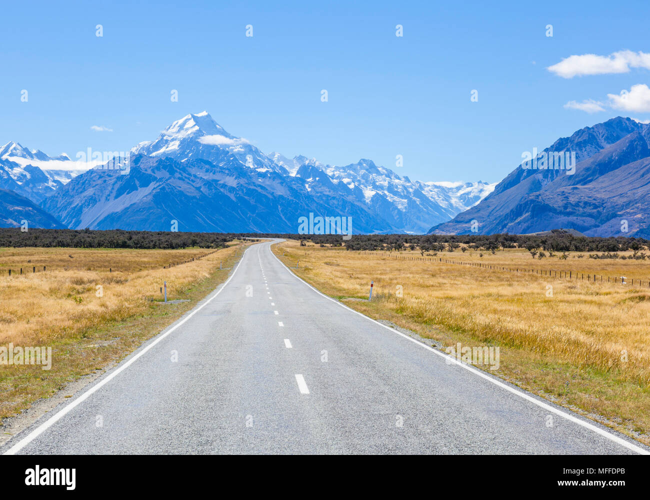 new zealand south island new zealand a straight empty road with no traffic in mount cook national park new zealand - Stock Image