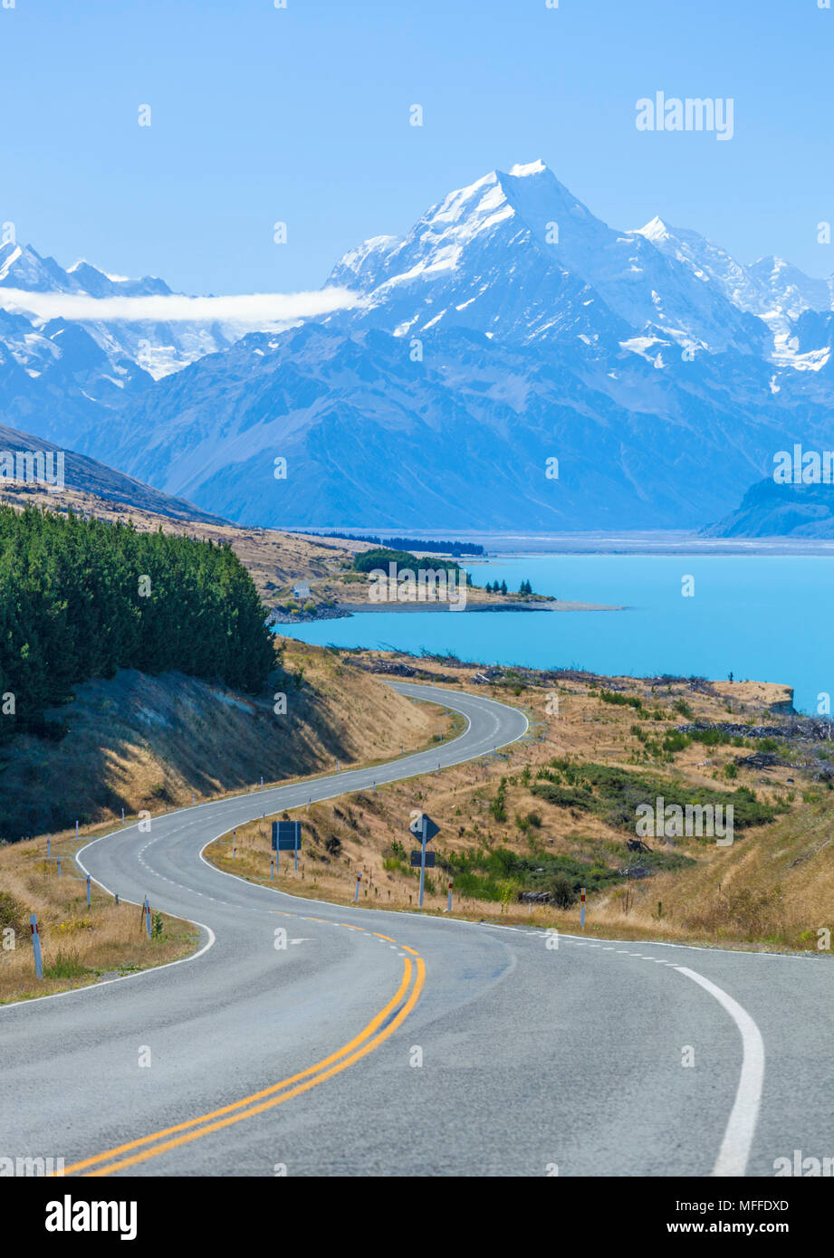 new zealand south island new zealand a winding road with no traffic in mount cook national park by the side of lake pukaki new zealand - Stock Image