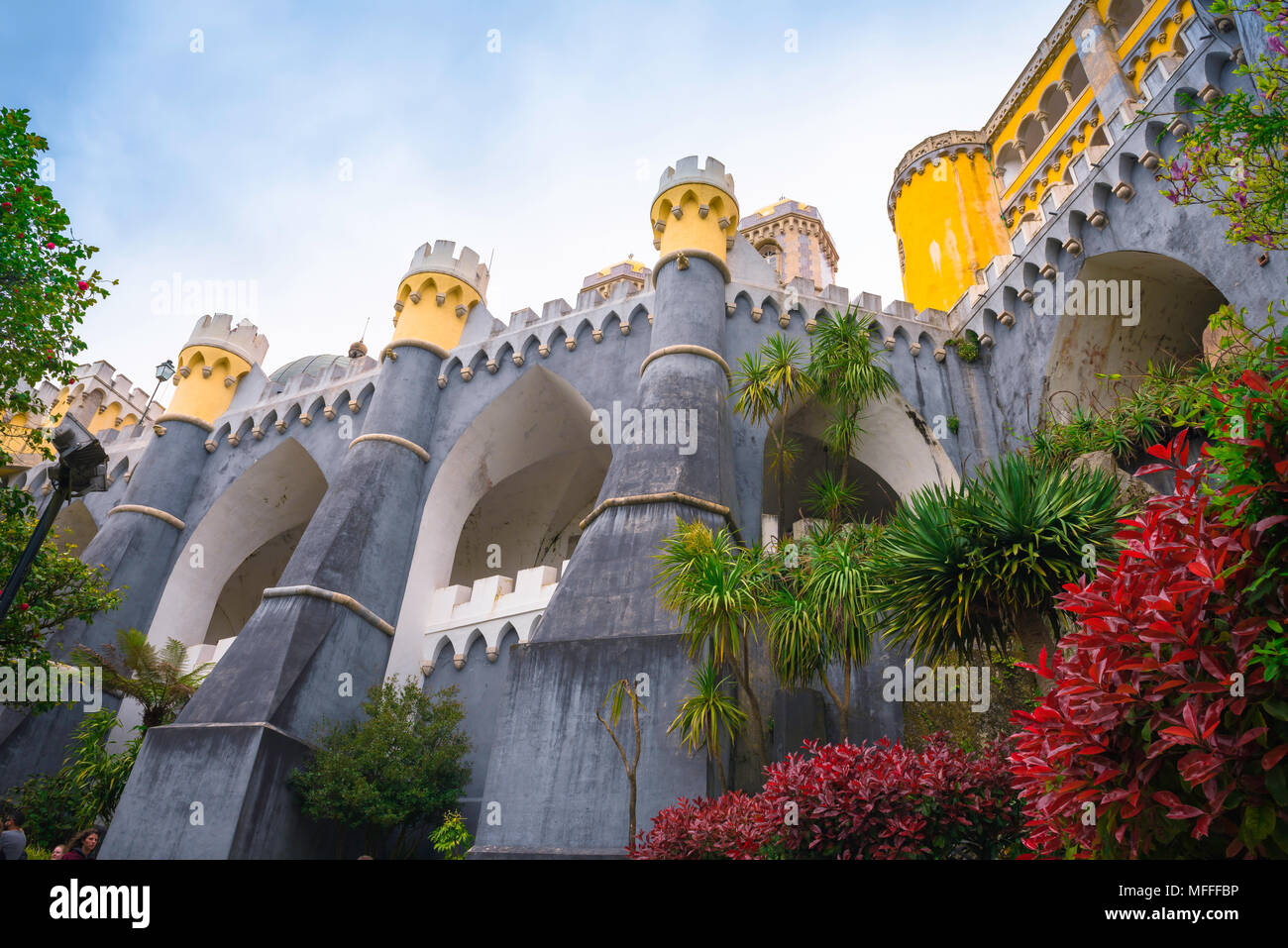 Sintra Portugal, view of the huge ramparts and buttresses supporting the colorful Palacio da Pena in Sintra, Portugal. Stock Photo
