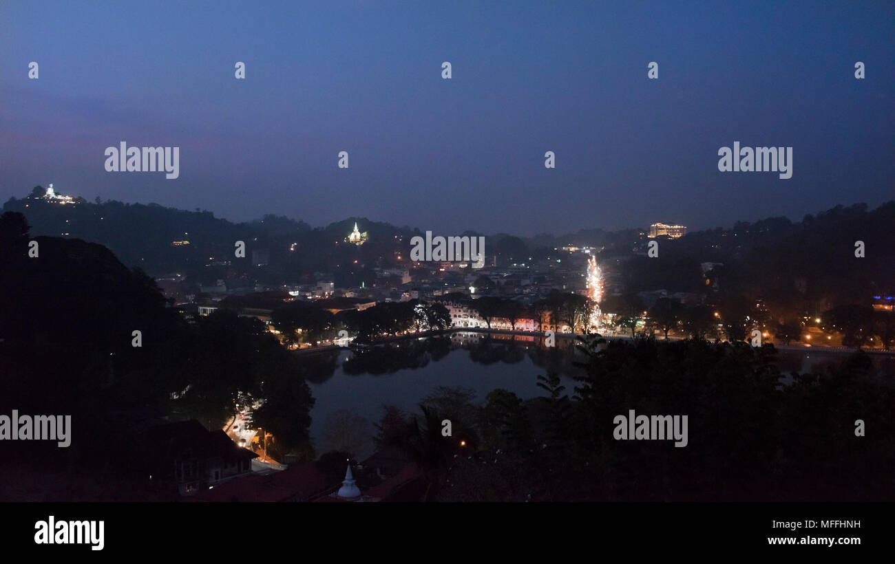 Horizontal panoramic cityscape of Kandy at night, Sri Lanka. - Stock Image