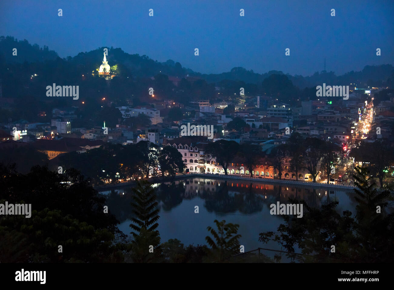 Horizontal cityscape of Kandy at night, Sri Lanka. - Stock Image