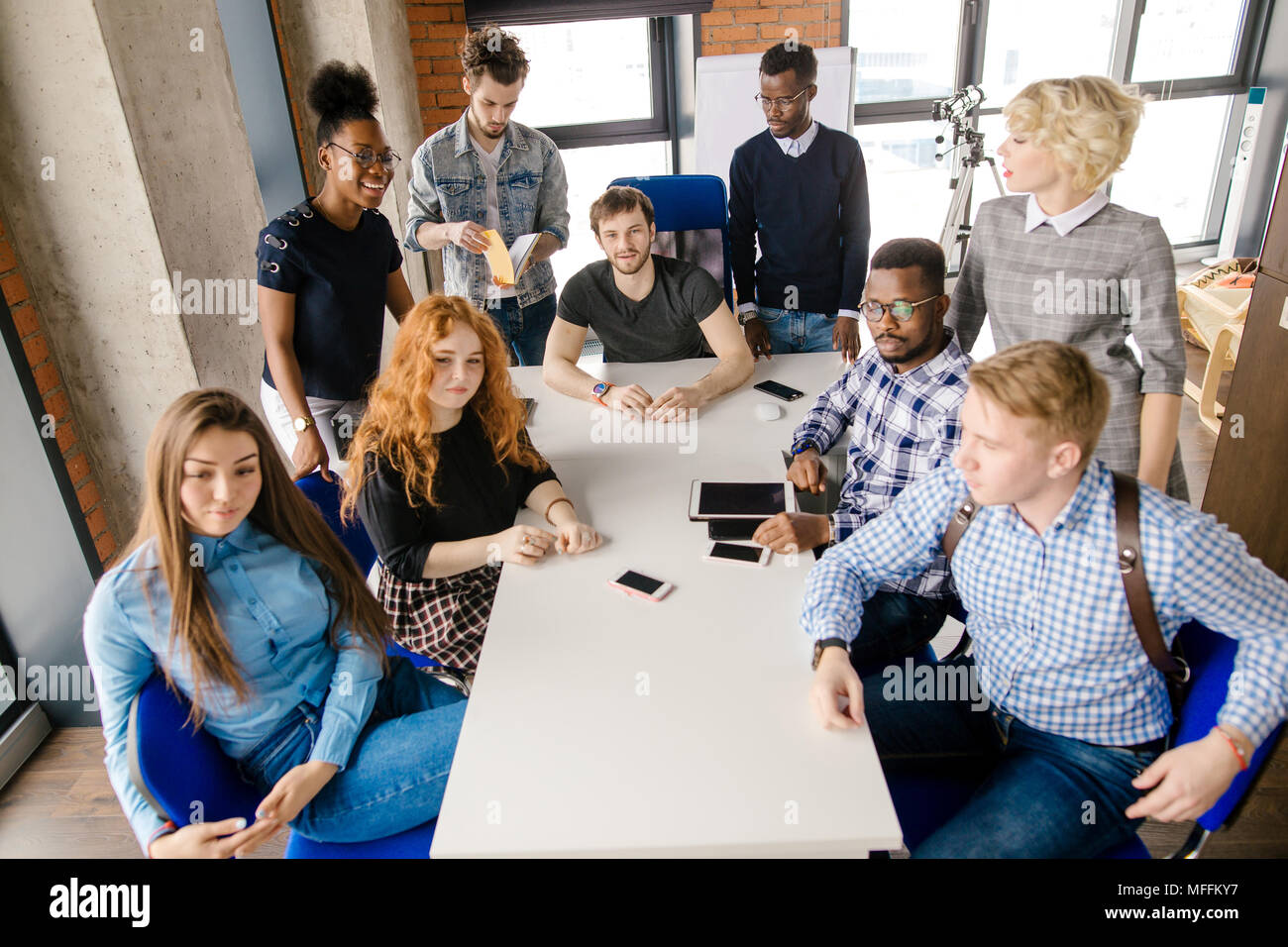 closeup shot of seminar for mixes race engineers in the loft office - Stock Image
