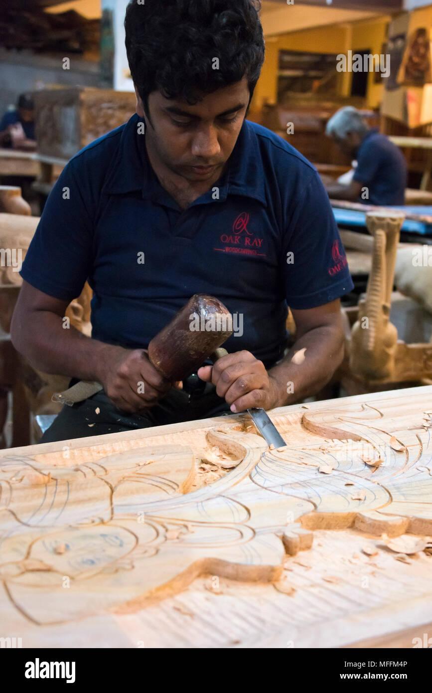 Vertical portrait of a woodcarver in Sri Lanka. - Stock Image