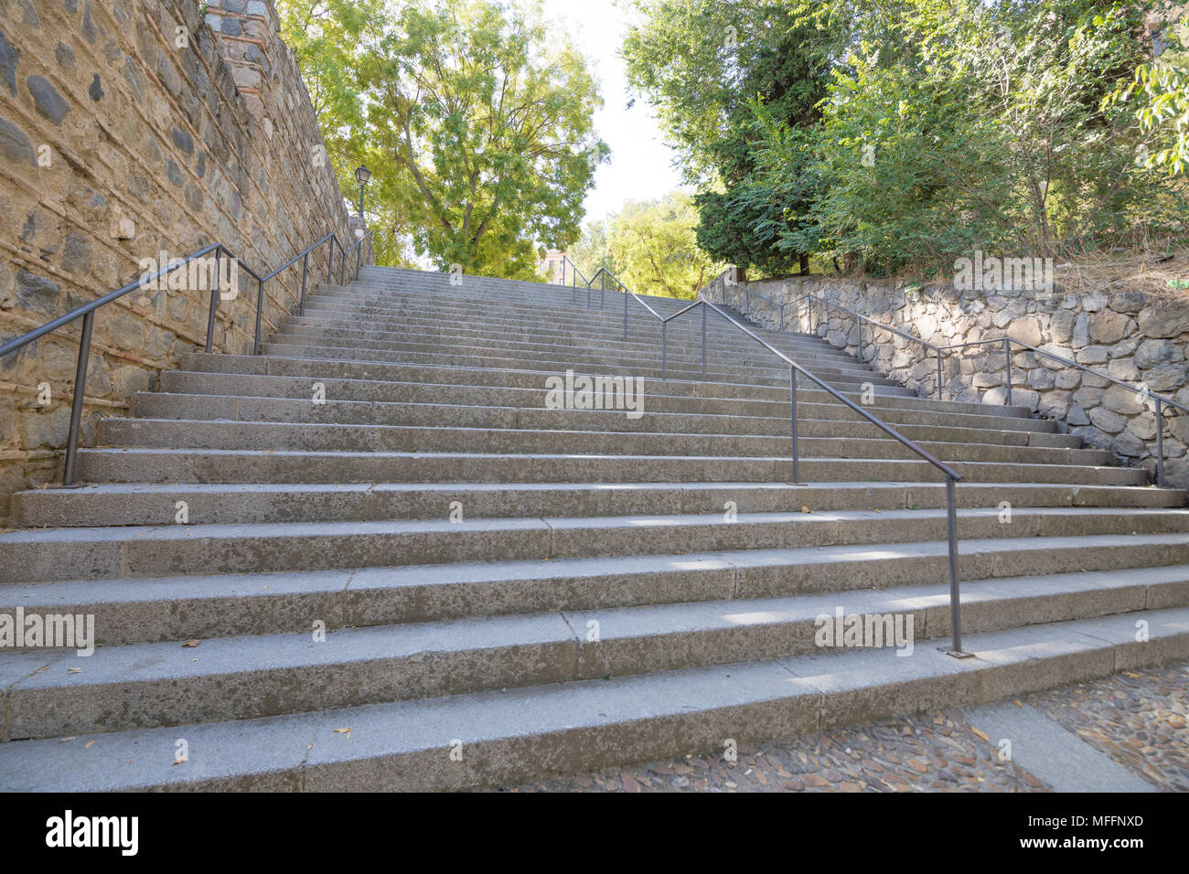 stone stairs with metal balusters going up in Toledo city, Spain, Europe Stock Photo