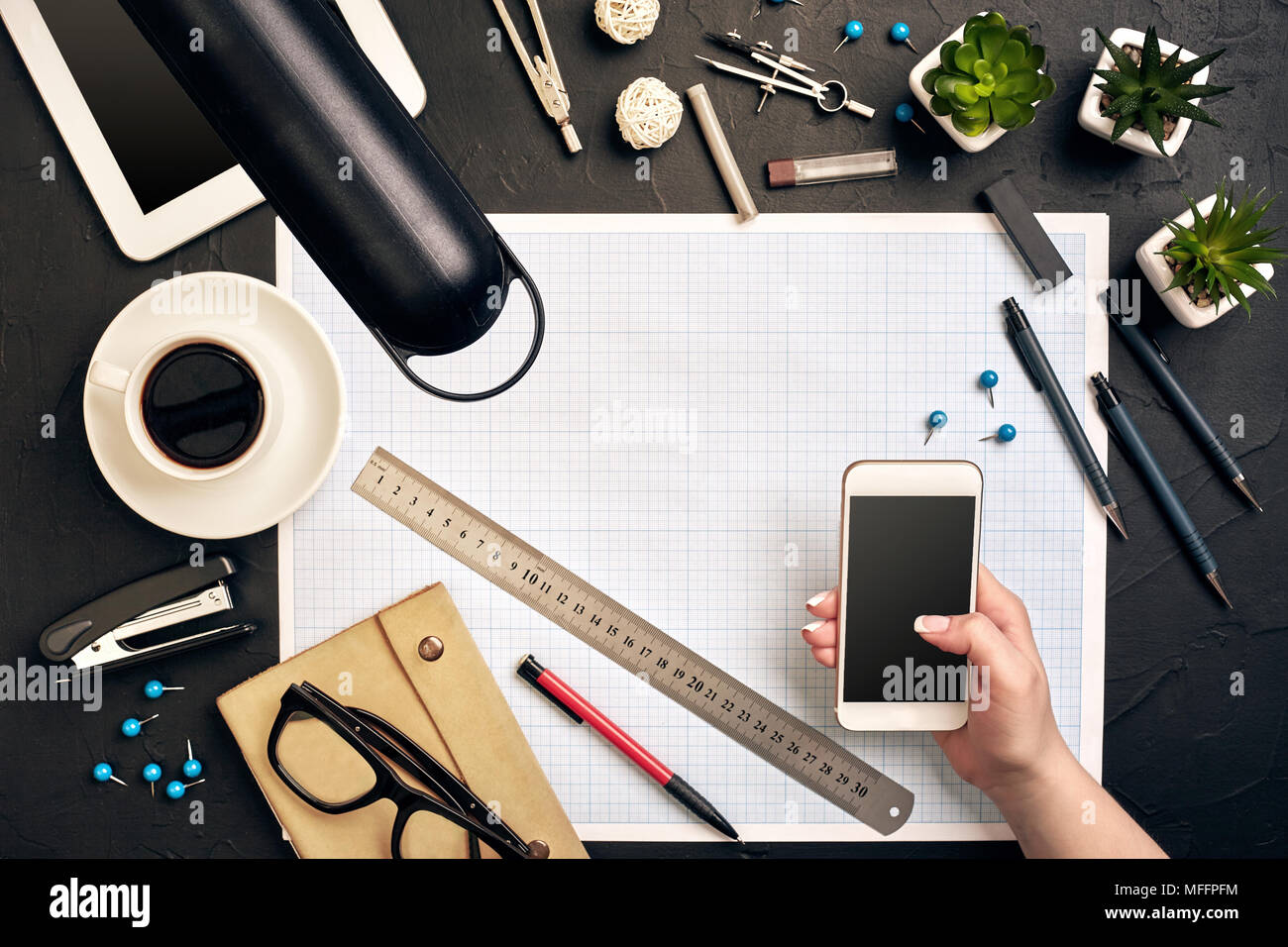 Architects tools stock photos architects tools stock images alamy architect working on blueprint architects workplace architectural project blueprints tablet pc malvernweather