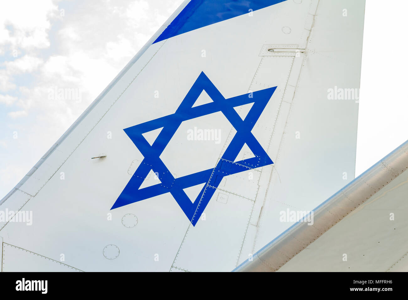 Tailplane of an airplane with a drawing of the Israeli flag. - Stock Image