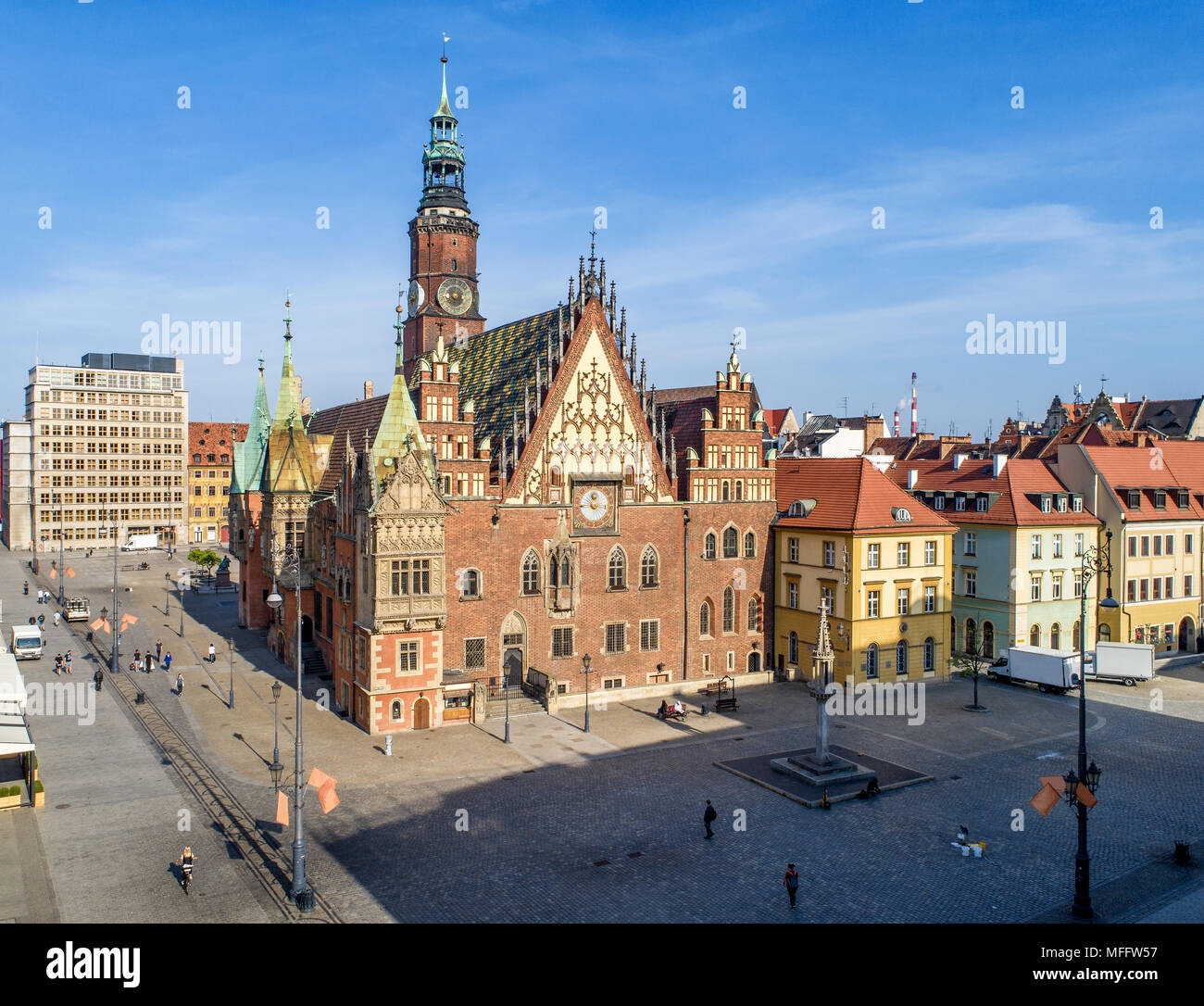 Old Gothic city hall in Wroclaw (Breslau) in Poland, built in 14th century and historic market square (Rynek). Aerial view. Early morning - Stock Image