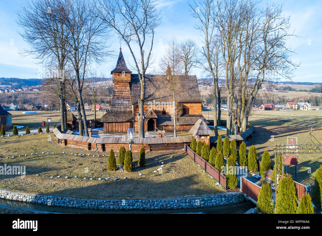 Debno, Poland. Medieval wooden Gothic church of the Saint Archangel Michael, built in 15th century, still active. Aerial view. - Stock Image