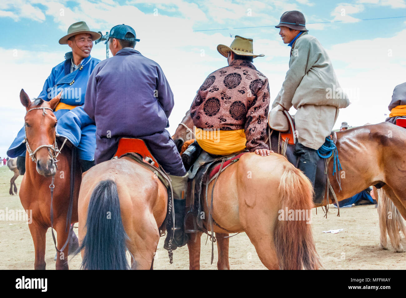 Khui Doloon Khudag, Mongolia - July 12, 2010: Horsemen in traditional costume at Nadaam horse race on steppe outside capital Ulaanbaatar - Stock Image