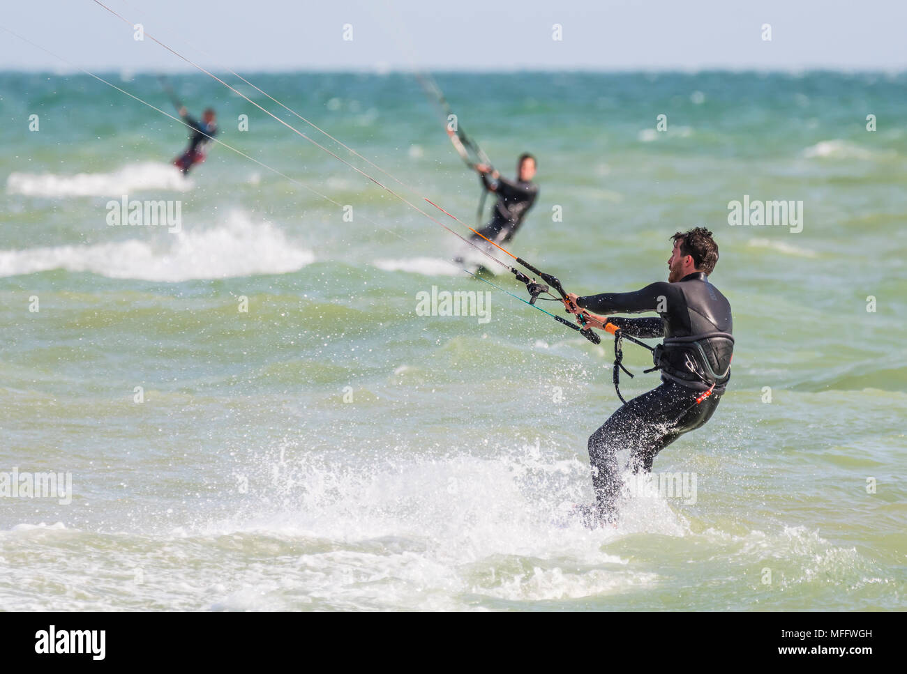 Mae kitesurfing at sea. Kitesurfers on the ocean. Watersports. - Stock Image
