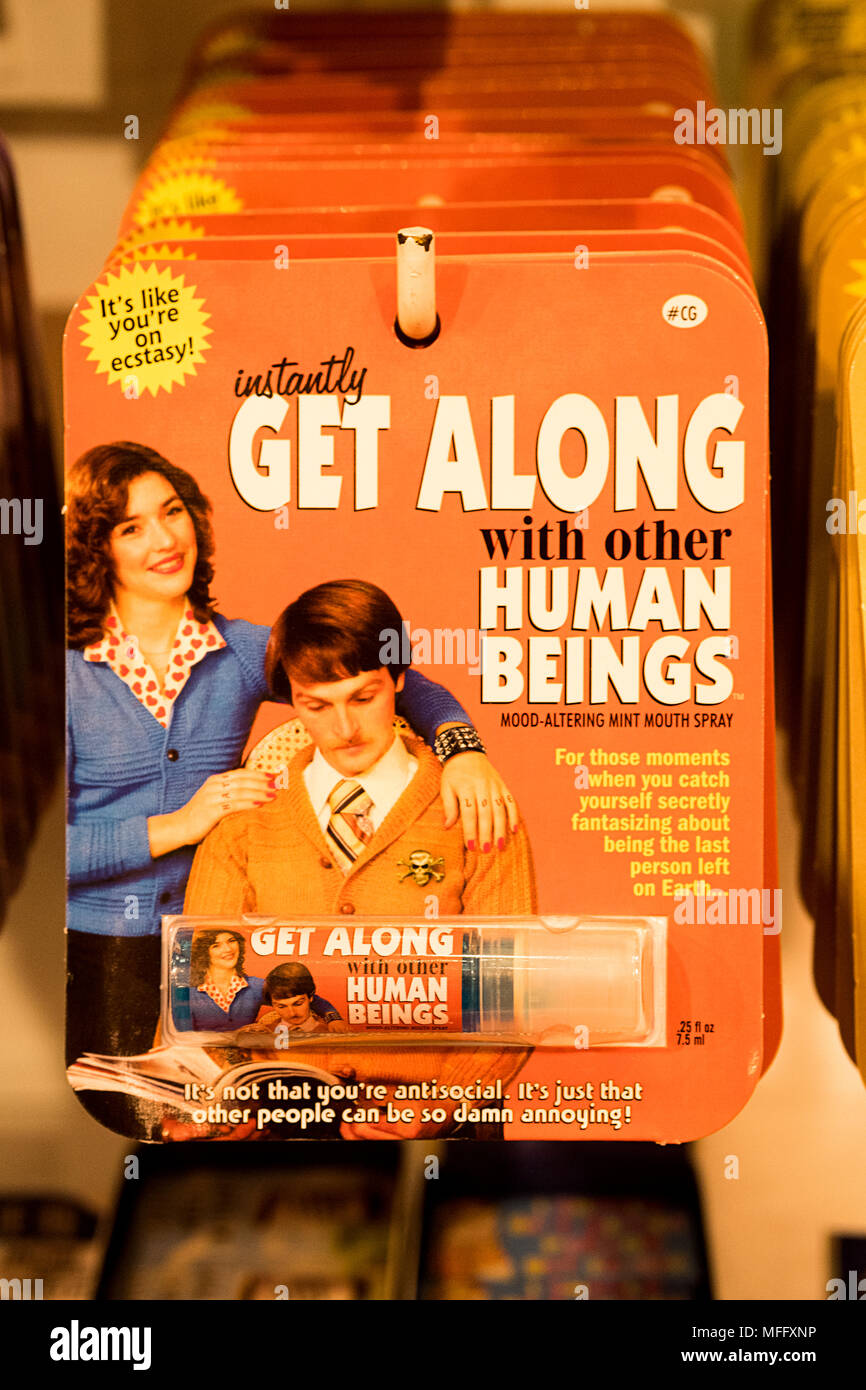 A mouth spray that promises to allowp one to instantly get along with other human beings. A gag gift for sale at Itsugar in Greenwich Village, New Yor - Stock Image