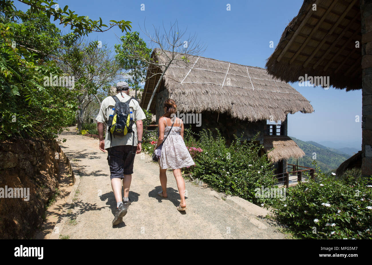 Tourists walking to their lodge in the 98 Acres Resort  and Spa in Ella, Sri Lanka Stock Photo