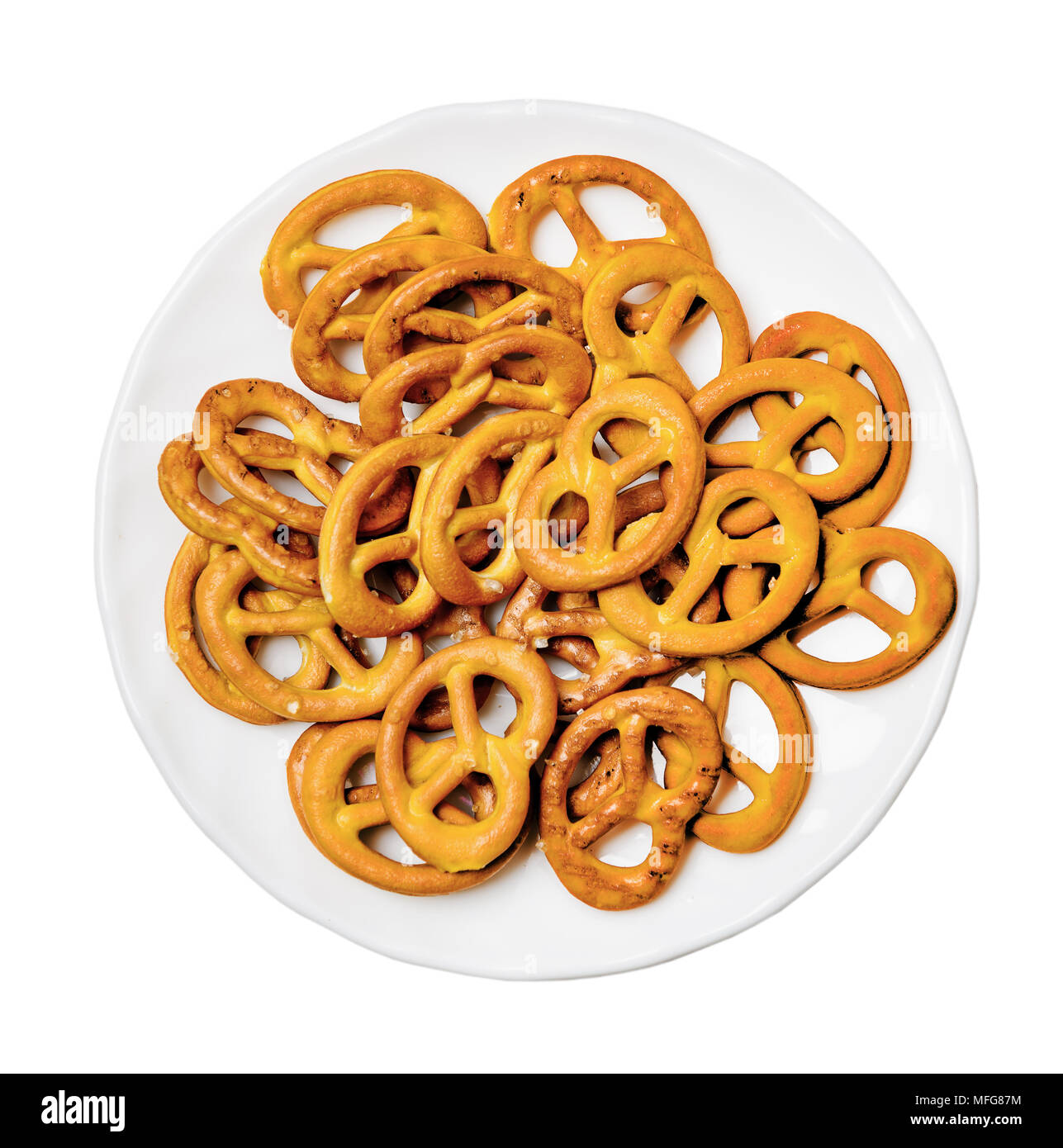 Salt pretzels on plate isolated white Top view - Stock Image