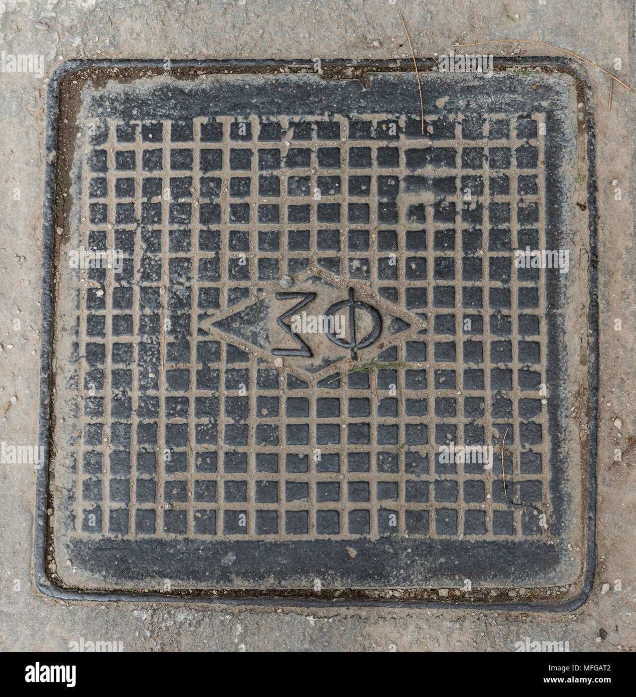 Sigma Phi Square manhole cover in Athens Greece Stock Photo