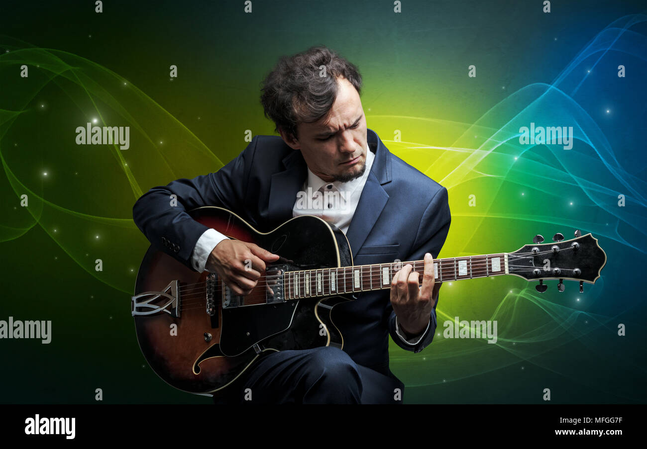 Serious classical guitarist with fabled sparkling wallpaper - Stock Image