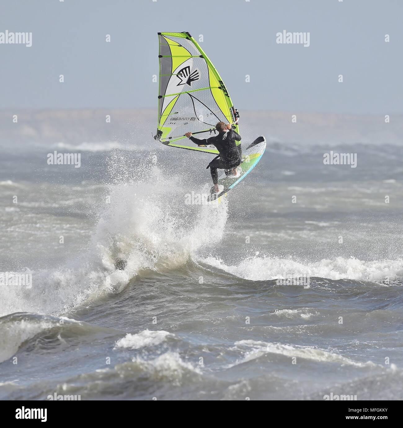 Wind Surfing on Avon Beach - Stock Image