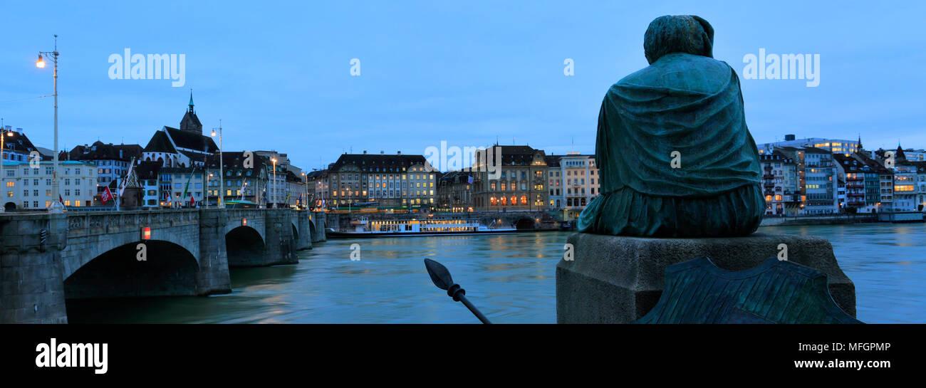 Dusk, the statue of Helvetia, Mittlere Brücke bridge, river Rhine, city of Basel, Canton Basel Stadt, Switzerland, Europe - Stock Image