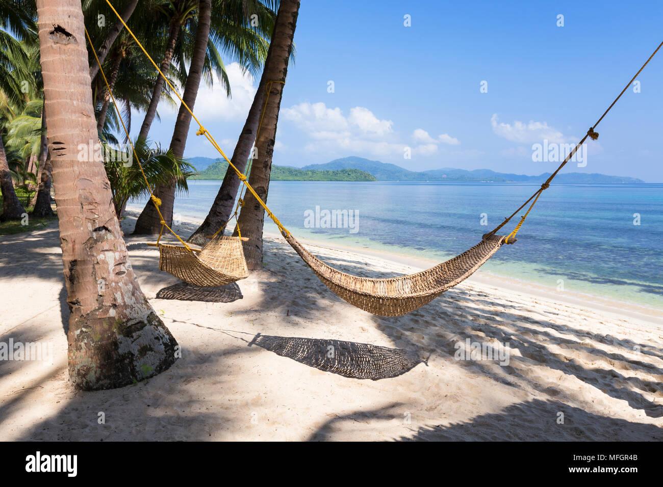 Hammock on tropical beach, white beach, near Port Barton, Palawan island, Philippines - Stock Image