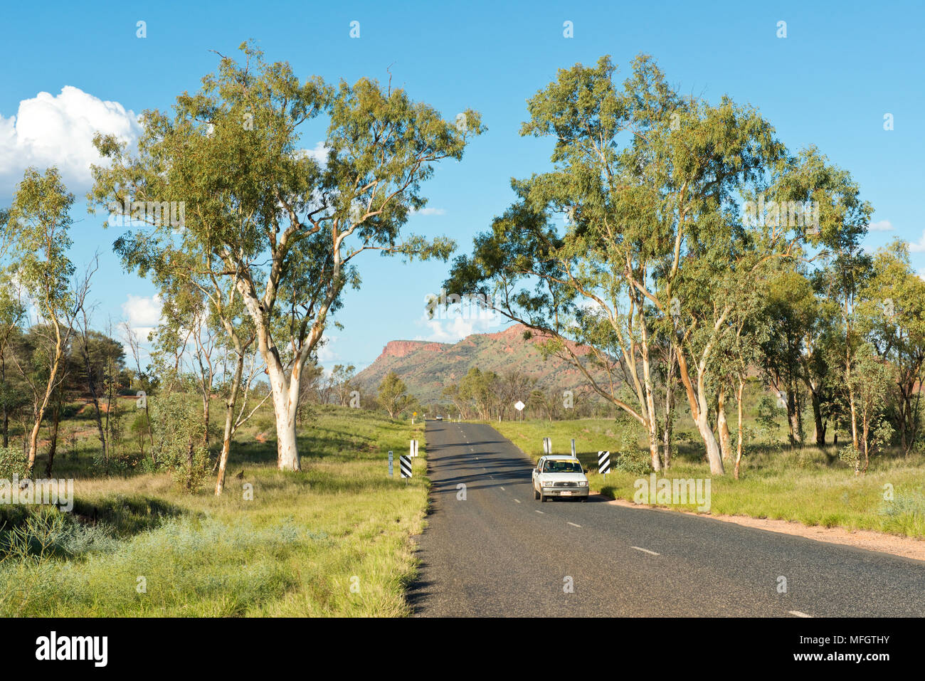 Car driving along Larapinta Drive. State Highway 6 to the west of Alice Springs. Northern Territory, Australia. - Stock Image