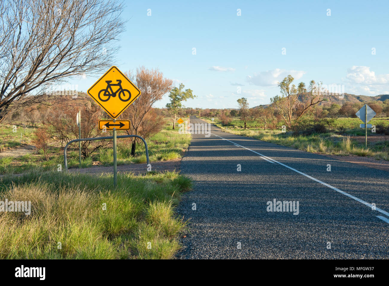 Bicycle road sign. On road from Simpsons Gap. Alice Springs, Northern Territory - Stock Image