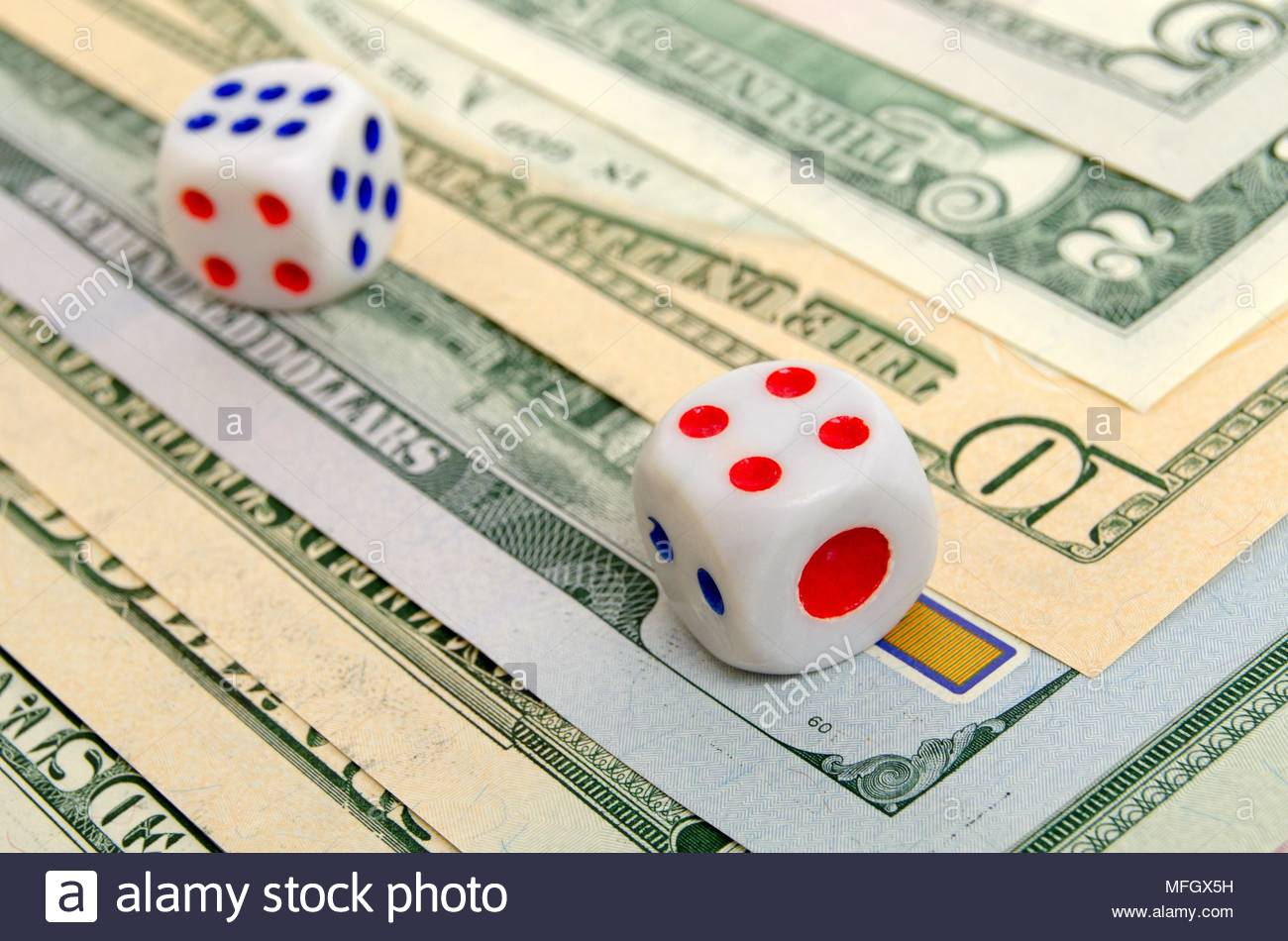 Dices are on the US dollar. - Stock Image