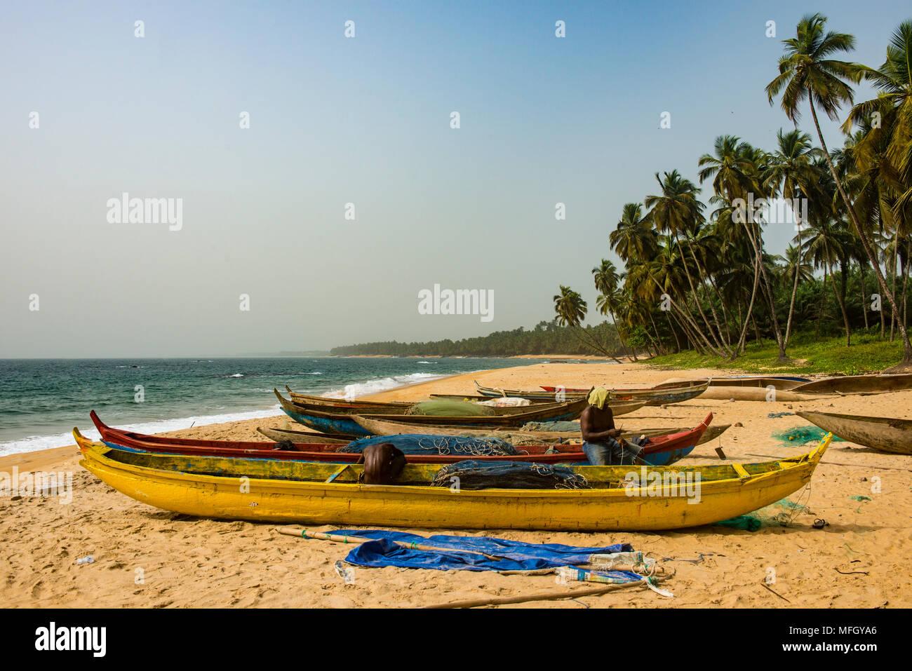 Fishing boats on a beautiful beach, Neekreen near Buchanan, Liberia, West Africa, Africa - Stock Image
