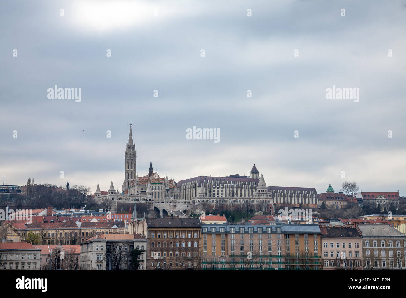 Buda Castle seen from Pest with the Matthias Church in front.  The cast is the historical palace complex of the Hungarian kings   Picture of Buda Cast Stock Photo