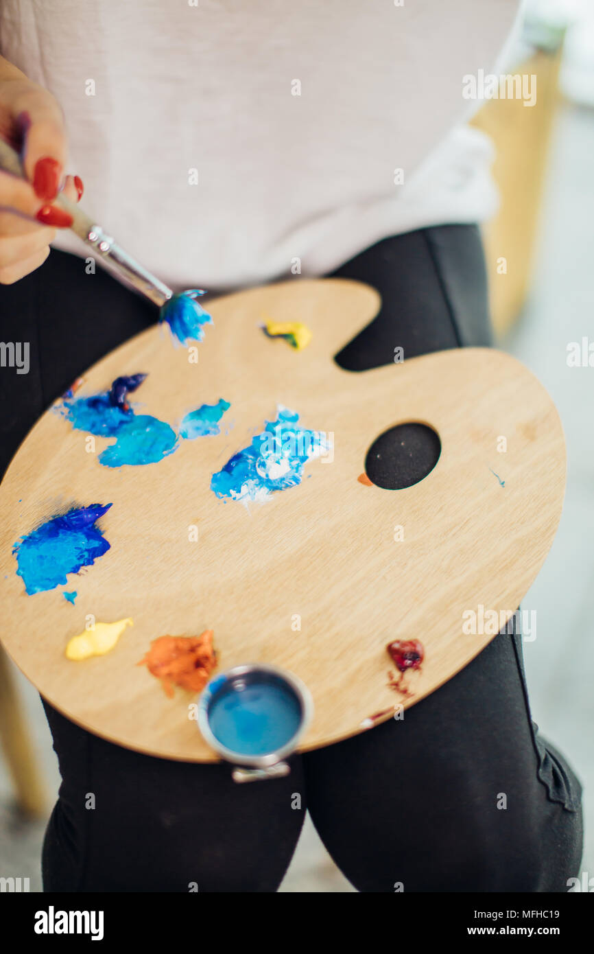Mix color oil painting on wooden palette closeup - Stock Image