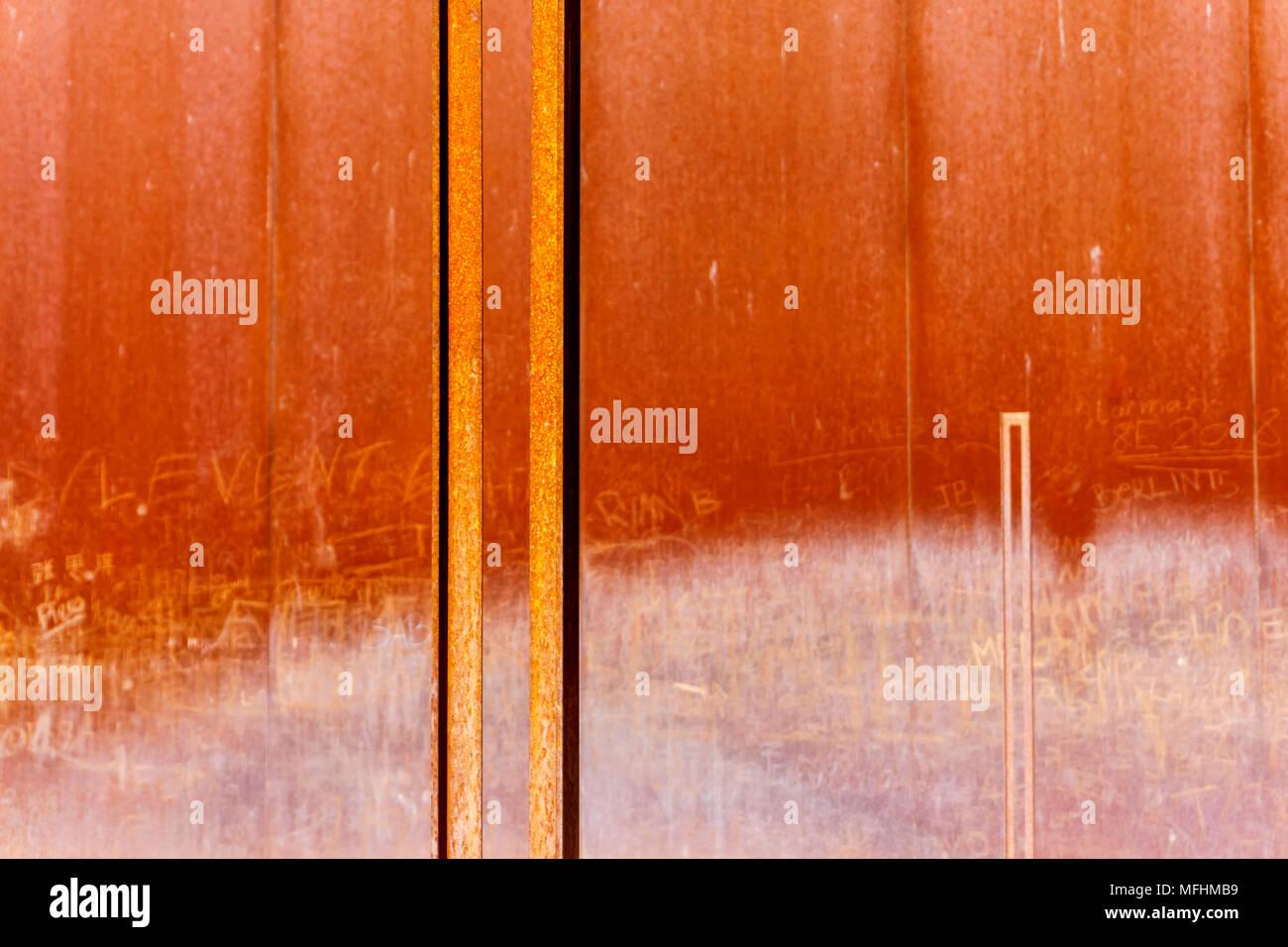 Rusty metal wall installation at Berlin Wall Memorial Park - Stock Image