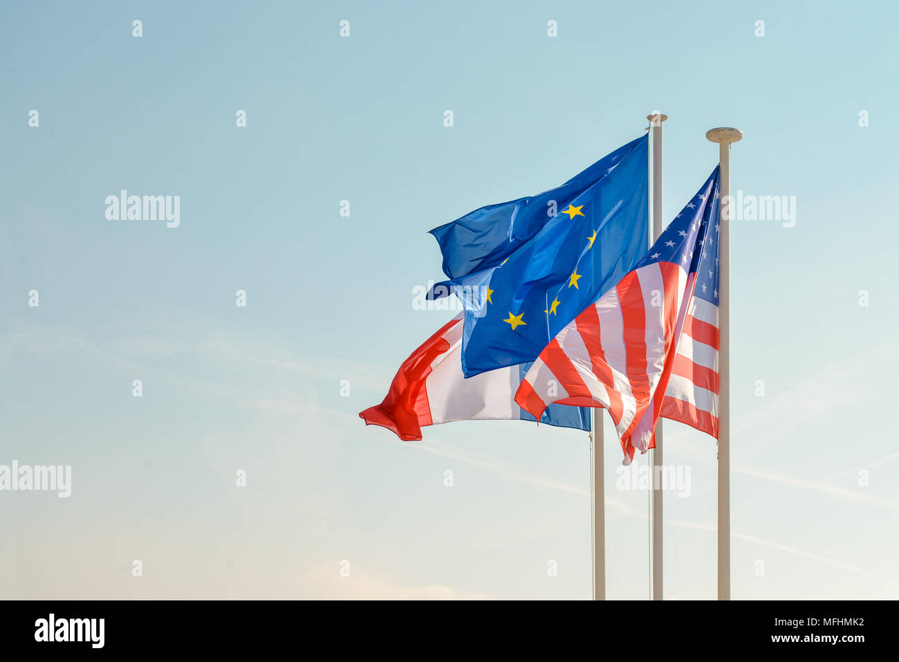 French American and European union Flags on blue sky - Stock Image