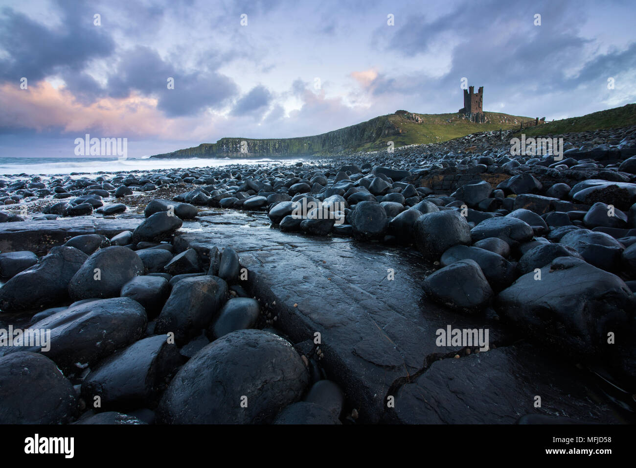The ruins of Dunstanburgh Castle from close to Embleton, Northumberland, England, United Kingdom, Europe - Stock Image