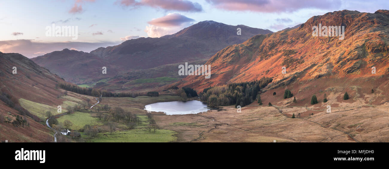 Stitched panoramic image showing sunrise at Blea Tarn in autumn, Lake District National Park, UNESCO, Cumbria, England, United Kingdom, Europe - Stock Image