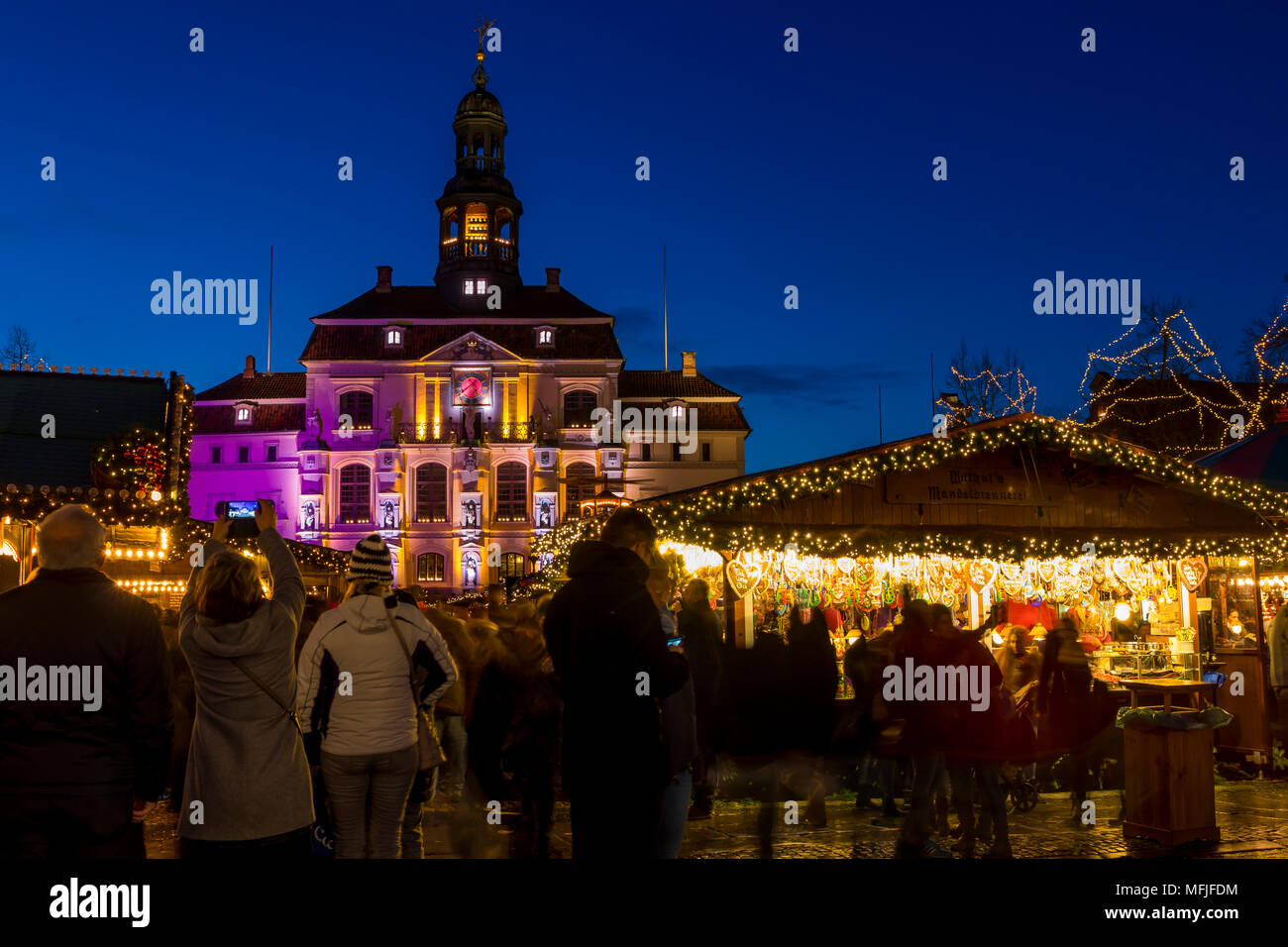 Christmas market at the main square of Luneburg with view to the town hall at dusk, Luneburg, Lower Saxony, Germany, Europe Stock Photo
