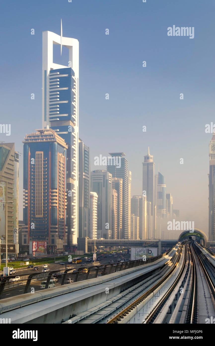 View of the Dubai metro rapid transit rail network and skyscrapers, Dubai, United Arab Emirates, Middle East - Stock Image