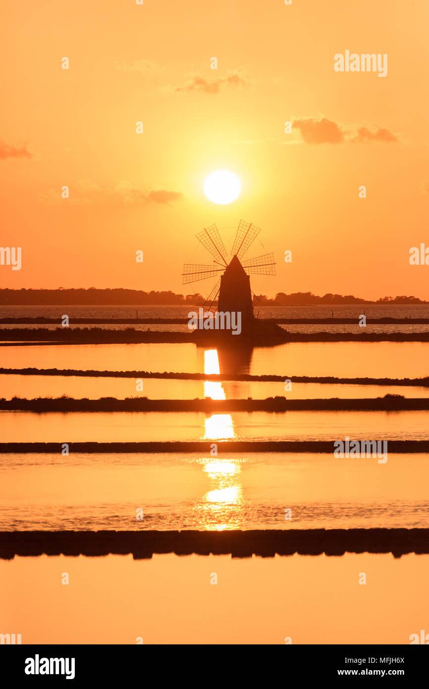Windmill at sunset, Saline dello Stagnone, Marsala, province of Trapani, Sicily, Italy, Mediterranean, Europe - Stock Image